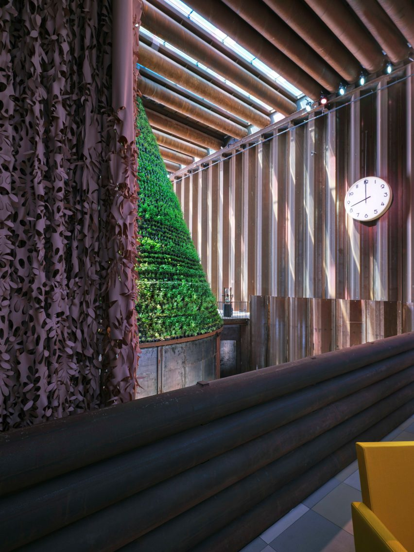 A curtain made of bio-based textile partitions the VIP lounge from the Dutch Biotope pavilion exhibition space