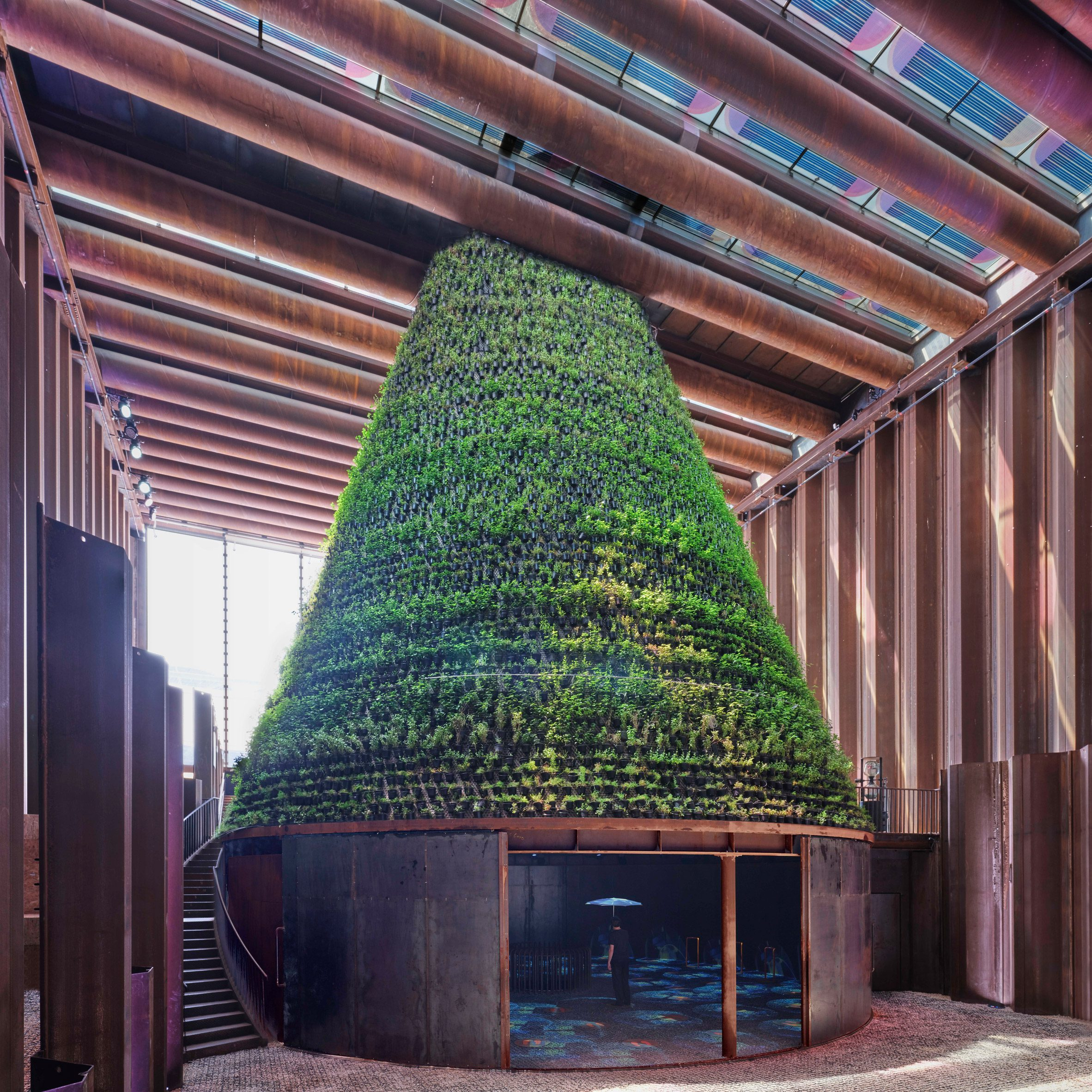 Plant-covered cone stands in the middle of the Dutch Biotope pavilion at Expo 2020 Dubai