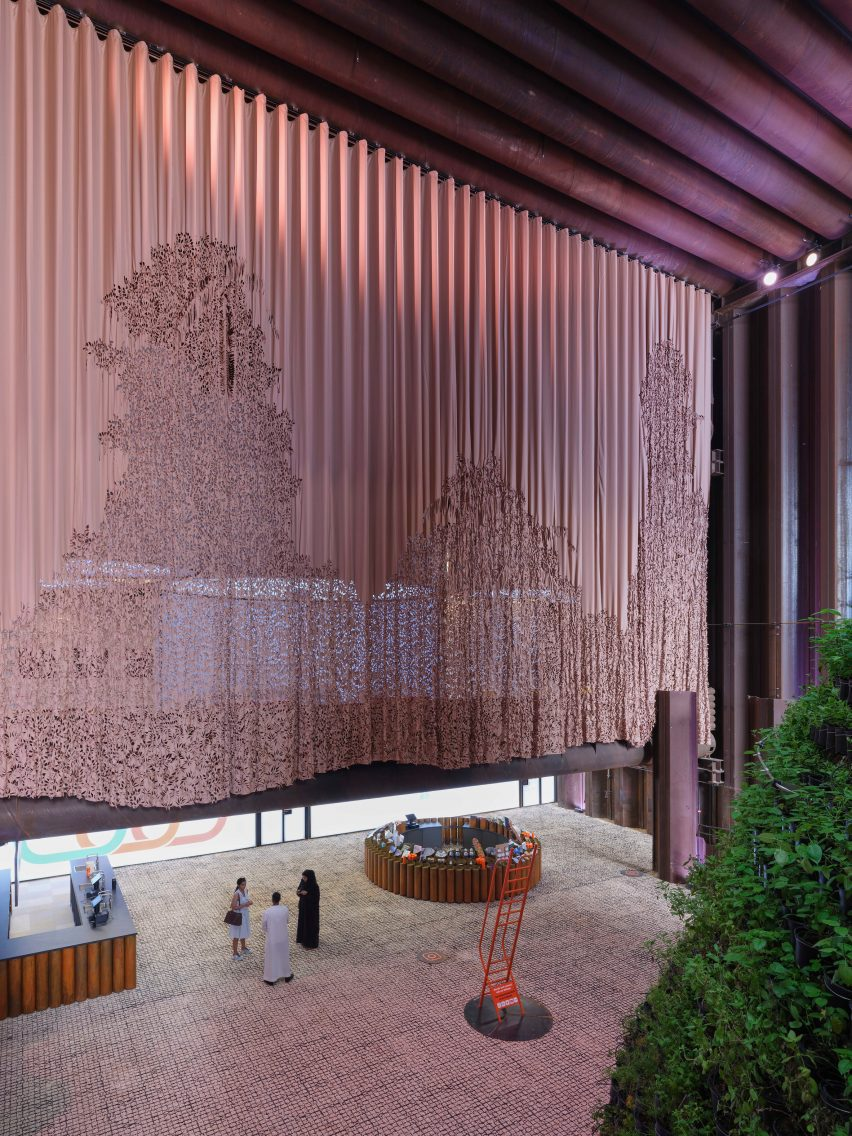 Beige patterned curtain divides exhibition space in the Dutch Biotope pavilion